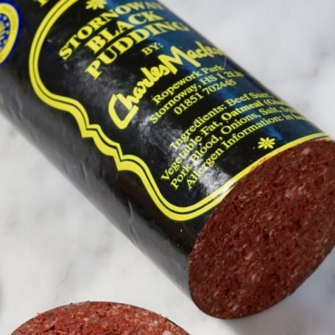 stornoway black pudding roll unsliced on white marble background