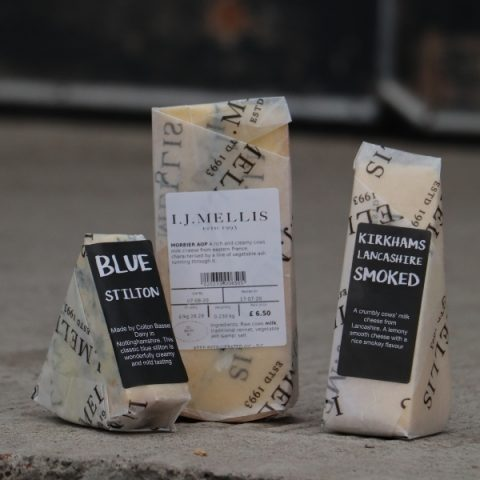 three prepacked cheeses on concrete