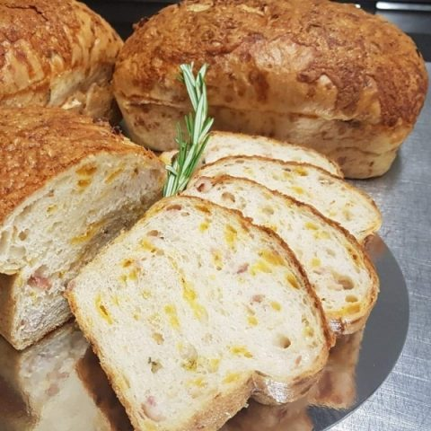 slices of smoked cheddar and rosemary bread