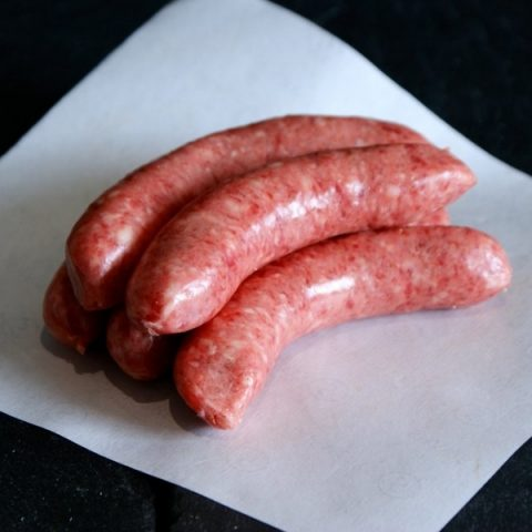 beef sausages on white paper