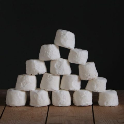 small blocks of chabis cheeses on wood