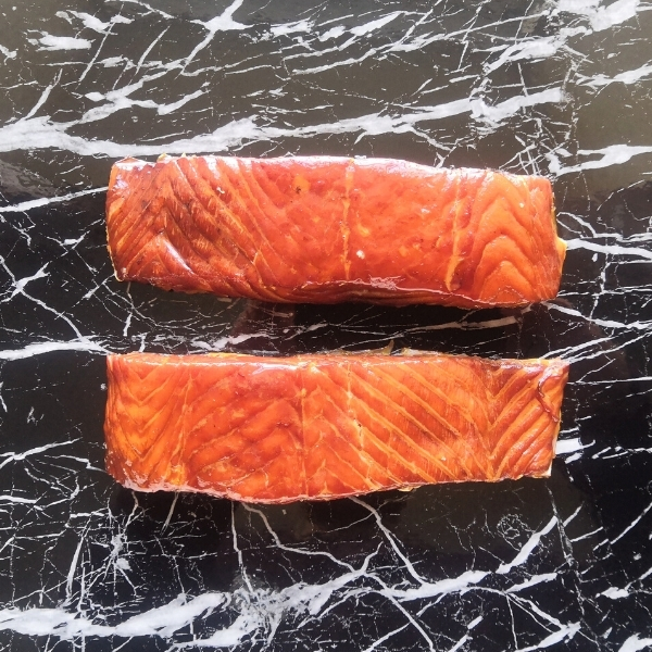 hot smoked salmon on black marble table