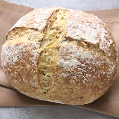 closeup of multi seed loaf on brown paper