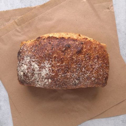 Multi seed tin bread on a brown paper from above