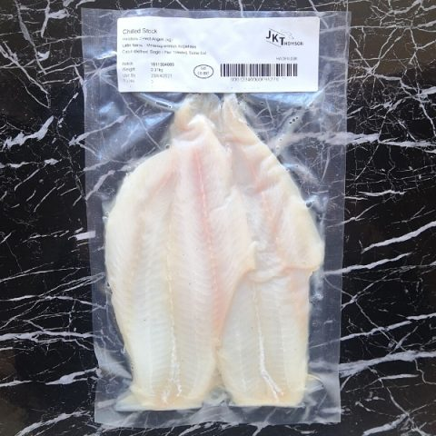 packed haddock fillets on black marble