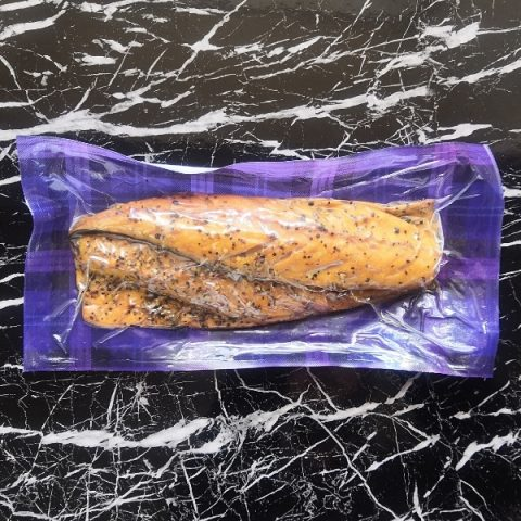 packed peppered mackerel on black marble top