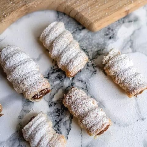 argentinian canoncitos pastries on white and grey marble
