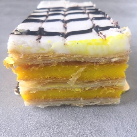 french pastry mille-feuille on grey background