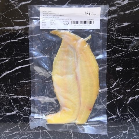 packed smoked haddock on black marble background