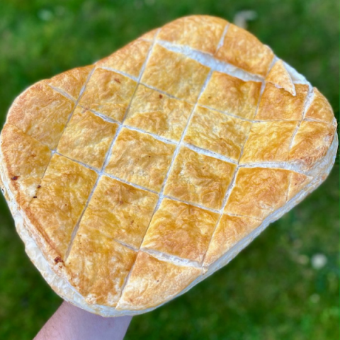 Large size beef steak pie holded in one hand