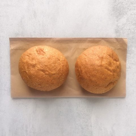 two scottish morning rolls brown on brown paper